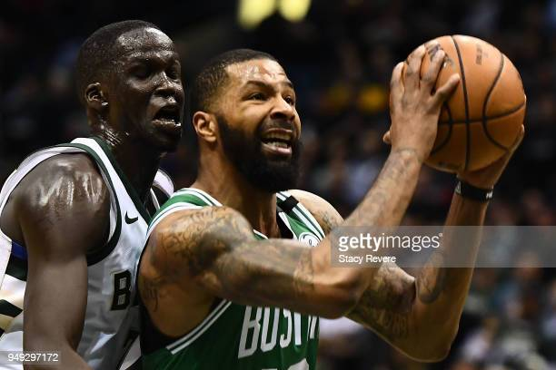 Marcus Morris of the Boston Celtics is defended by Thon Maker of the Milwaukee Bucks during the first half of game three of round one of the Eastern...