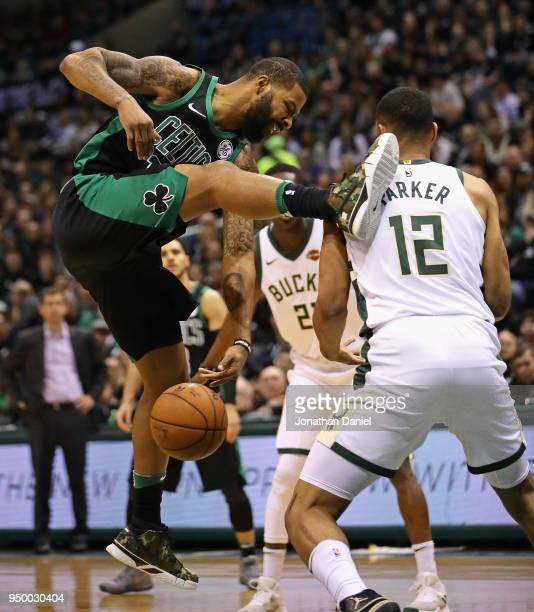Marcus Morris of the Boston Celtics looses control of the ball under pressure from Jabari Parker of the Milwaukee Bucks during Game Four of Round One...