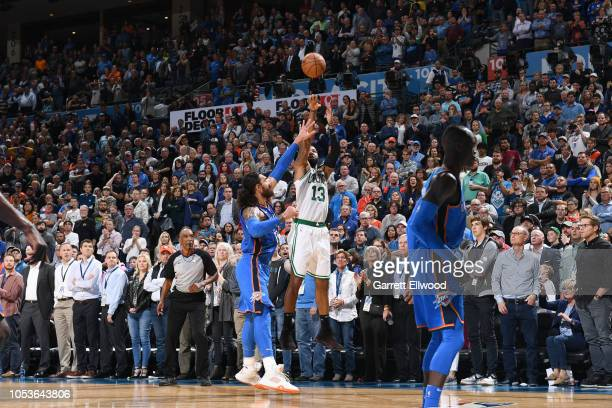 Marcus Morris of the Boston Celtics makes a three point basket to take the lead late in the 4th quarter against the Oklahoma City Thunder on October...