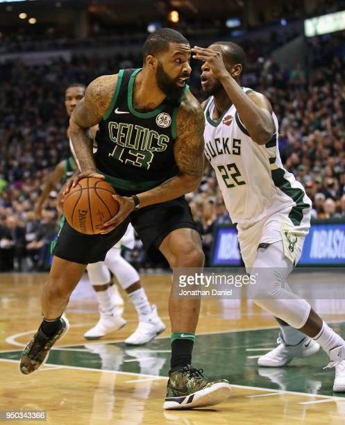 Marcus Morris of the Boston Celtics moves against Khris Middleton of the Milwaukee Bucks during Game Four of Round One of the 2018 NBA Playoffs at...