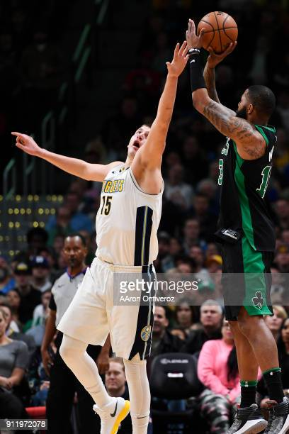 Marcus Morris of the Boston Celtics shoots over Nikola Jokic of the Denver Nuggets during the second half of the Celtics' 111110 win on Monday...