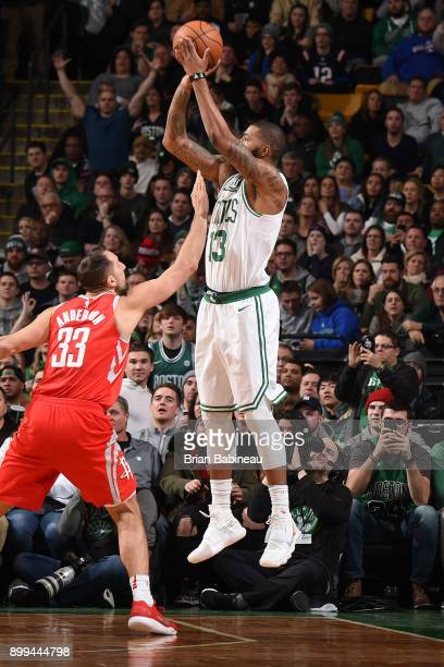 Marcus Morris of the Boston Celtics shoots the ball against the Houston Rockets on December 28 2017 at the TD Garden in Boston Massachusetts NOTE TO...