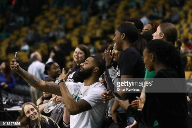 Marcus Morris of the Boston Celtics takes selfies with fans before the game between the Boston Celtics and the LA Clippers at TD Garden on February...