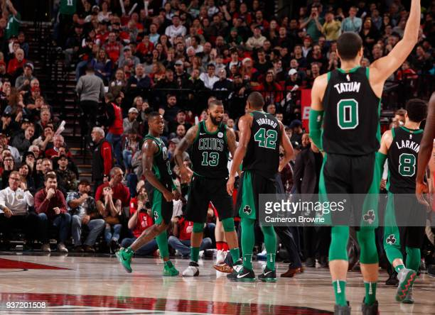 Marcus Morris of the Boston Celtics with his teammates celebrate a win against the Portland Trail Blazers on March 23 2018 at the Moda Center in...