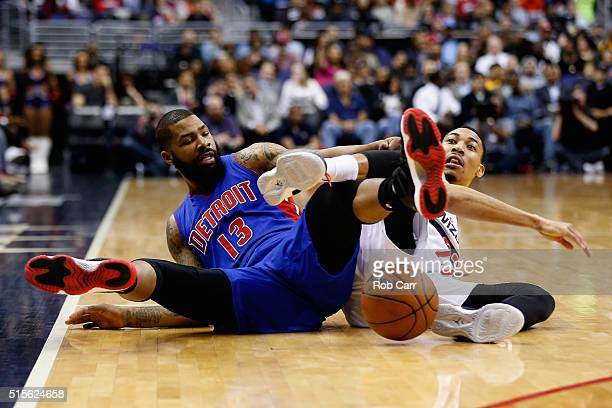 Marcus Morris of the Detroit Pistons and Otto Porter Jr #22 of the Washington Wizards go after a loose ball in the first half at Verizon Center on...