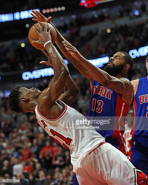 Marcus Morris of the Detroit Pistons blocks a shot by Jimmy Butler of the Chicago Bulls at the United Center on December 18 2015 in Chicago Illinois...