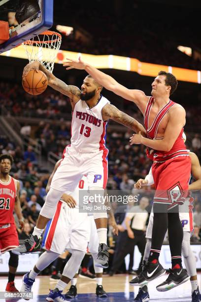 Marcus Morris of the Detroit Pistons grabs a rebound against Paul Zipser of the Chicago Bulls in the second half at the Palace of Auburn Hills on...