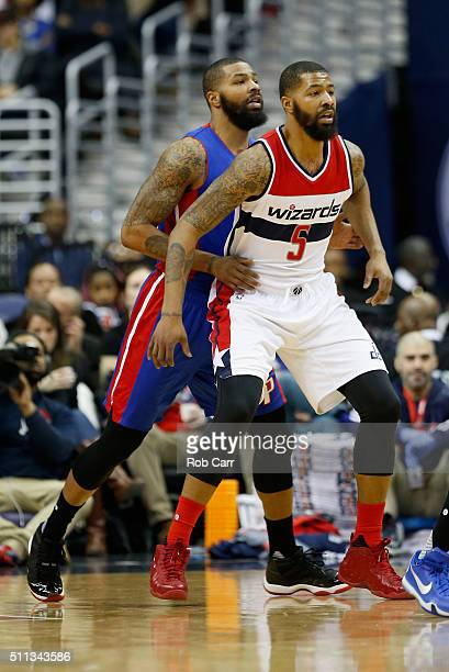 Marcus Morris of the Detroit Pistons guards his twin brother Markieff Morris of the Washington Wizards in the first half at Verizon Center on...