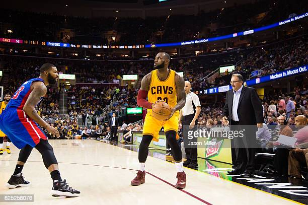 Marcus Morris of the Detroit Pistons guards LeBron James of the Cleveland Cavaliers during the second half at Quicken Loans Arena on November 18 2016...
