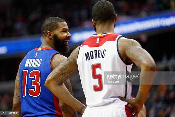 Marcus Morris of the Detroit Pistons talks with his twin brother Markieff Morris of the Washington Wizards in the first half at Verizon Center on...
