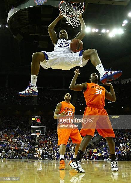 Marcus Morris of the Kansas Jayhawks dunks the ball against the Oklahoma State Cowboys during their quarterfinal game in the 2011 Phillips 66 Big 12...