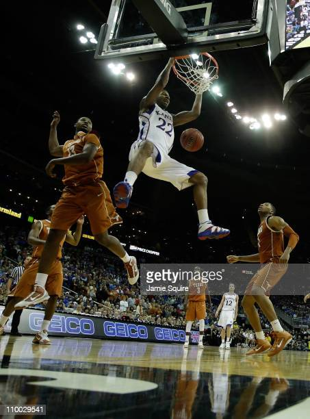 Marcus Morris of the Kansas Jayhawks dunks the ball against the Texas Longhorns during the 2011 Phillips 66 Big 12 Men's Basketball Tournament...