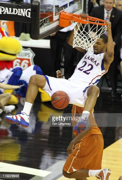 Marcus Morris of the Kansas Jayhawks dunks the ball in a game against the Texas Longhorns during the championship game of the 2011 Phillips 66 Big 12...