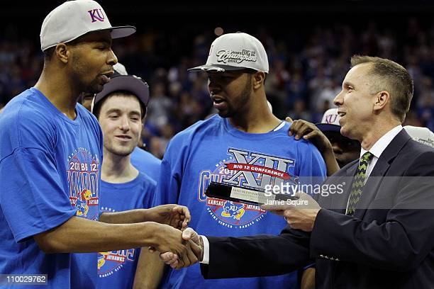 Marcus Morris of the Kansas Jayhawks is presented the Most Outstanding Player trophy following the Jayhawks 8573 win over the Texas Longhorns in the...