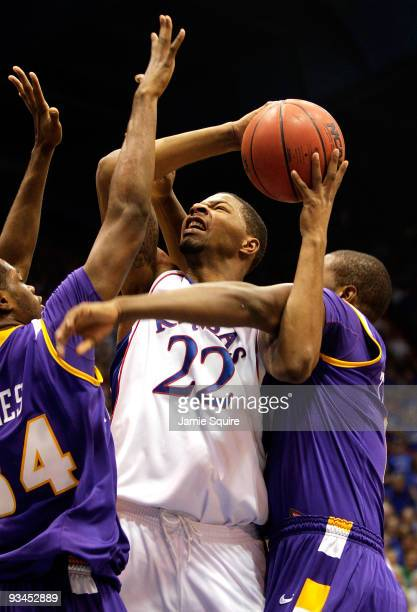 Marcus Morris of the Kansas Jayhawks shoots as Alfred Jones and Terrell Barnes of the Tennessee Tech Golden Eagles defend during the game on November...