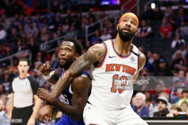 Marcus Morris of the New York Knicks boxes out Patrick Beverley of the LA Clippers on January 5 2020 at STAPLES Center in Los Angeles California NOTE...