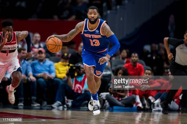 Marcus Morris of the New York Knicks dribbles the ball against the Washington Wizards during the first half at Capital One Arena on October 7 2019 in...