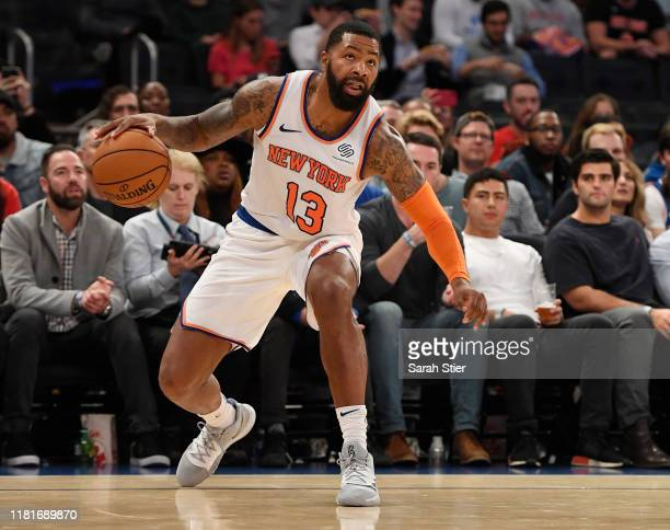 Marcus Morris of the New York Knicks dribbles the ball during the third quarter of the preseason game against the Atlanta Hawks at Madison Square...