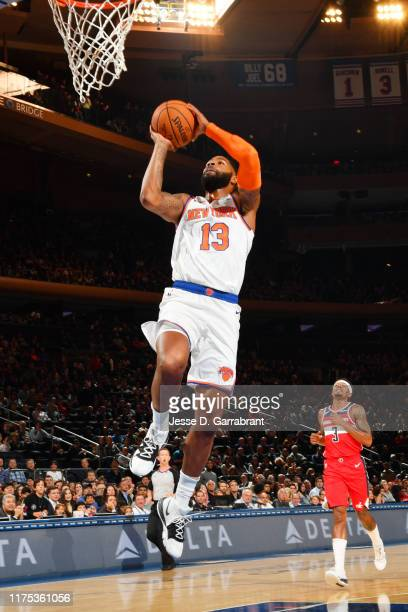 Marcus Morris of the New York Knicks dunks the ball against the Washington Wizards during a preseason game on October 11 2019 at Madison Square...