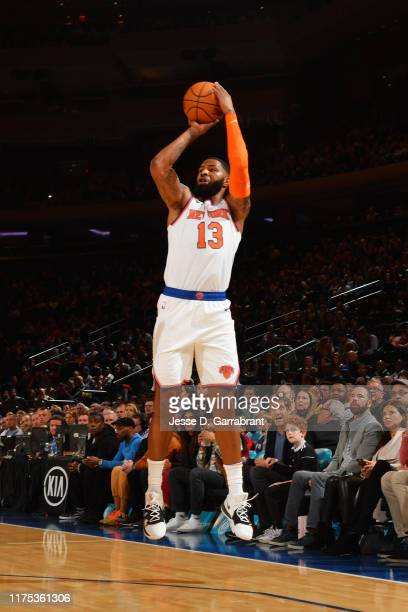 Marcus Morris of the New York Knicks shoots a threepointer against the Washington Wizards during a preseason game on October 11 2019 at Madison...