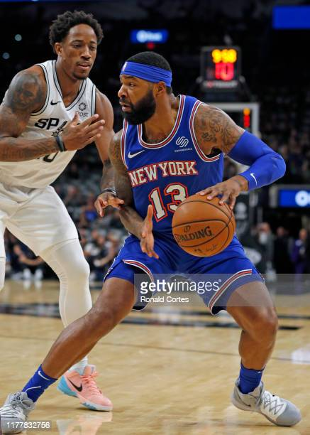 Marcus Morris of the New York Knicks tries to drive on DeMar DeRozan of the San Antonio Spurs at ATT Center on October 23 2019 in San Antonio Texas...