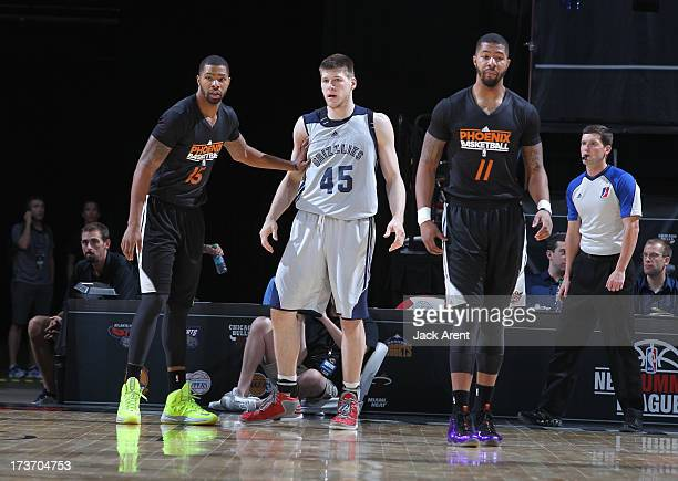 Marcus Morris of the Phoenix Suns guards Jack Cooley of the Memphis Grizzlies during the NBA Summer League game between the Memphis Grizzlies and the...