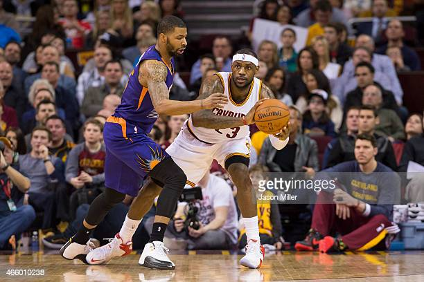 Marcus Morris of the Phoenix Suns guards LeBron James of the Cleveland Cavaliers during the first half at Quicken Loans Arena on March 7 2015 in...