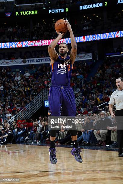 Marcus Morris of the Phoenix Suns shoots against the New Orleans Pelicans on December 30 2014 at Smoothie King Center in New Orleans Louisiana NOTE...