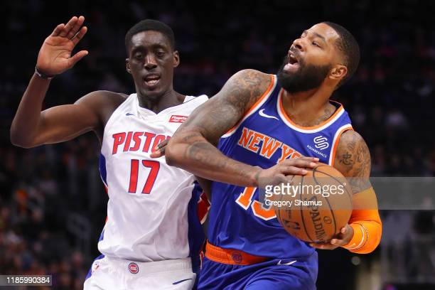 Marcus Morris Sr #13 of the New York Knicks battles with Tony Snell of the Detroit Pistons during the first half at Little Caesars Arena on November...