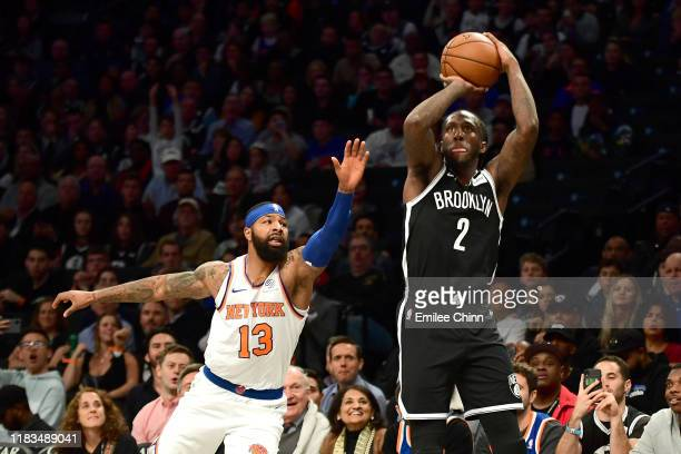 Marcus Morris Sr #13 of the New York Knicks guards Taurean Prince of the Brooklyn Nets as he shoots a threepointer in the first half of their game at...