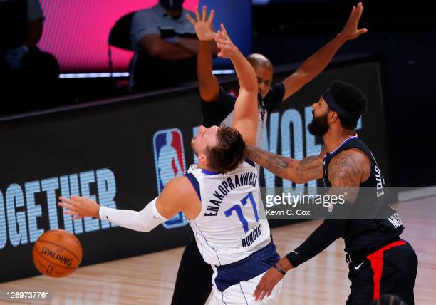 Marcus Morris Sr #31 of the LA Clippers fouls Luka Doncic of the Dallas Mavericks during the first quarter in Game Six of the Western Conference...