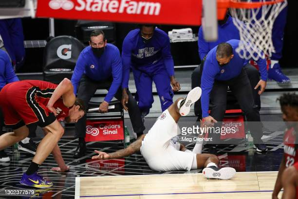 Marcus Morris Sr. #8 of the LA Clippers falls after making a three point basket while being fouled by Kelly Olynyk of the Miami Heat at Staples...