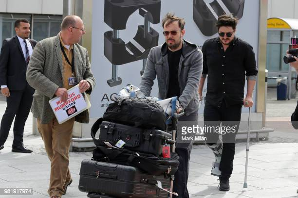 Marcus Mumford and Ben Lovett arriving at Aberdeen Airport before the wedding of Kit Harrington and Rose Leslie on June 23 2018 in Aberdeen Scotland