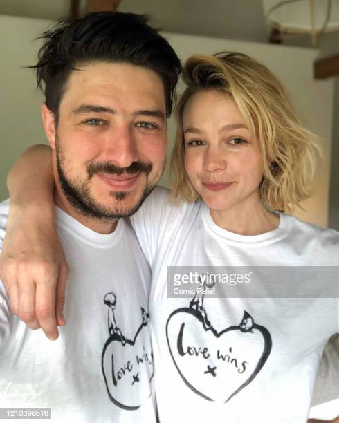 Marcus Mumford and Carey Mulligan wearing a limitededition tshirt created in collaboration with Charlie Mackesy featuring his beloved characters the...