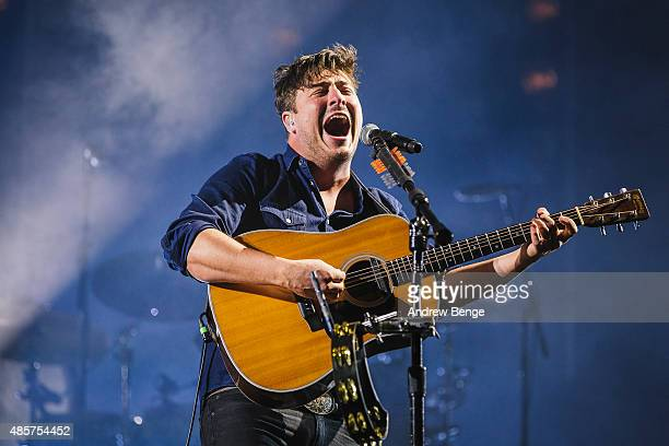 Marcus Mumford of Mumford and Sons performs on the main stage at Leeds Festival at Bramham Park on August 29 2015 in Leeds England