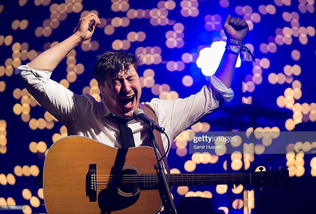 Marcus Mumford of Mumford & Sons performs as the headline the Pyramid Stage at the Glastonbury Festival of Contemporary Performing Arts at Worthy Farm, Pilton on June 30, 2013 in Glastonbury, England.