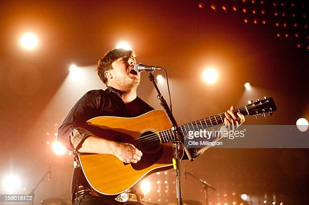Marcus Mumford of Mumford Sons performs during a date of their 2012 UK Arenas 'The Tour Of Two Halves' tour at Nottingham Capital FM Arena on...