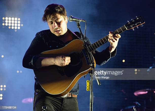 Marcus Mumford of Mumford Sons performs during Lollapalooza 2013 at Grant Park on August 3 2013 in Chicago Illinois