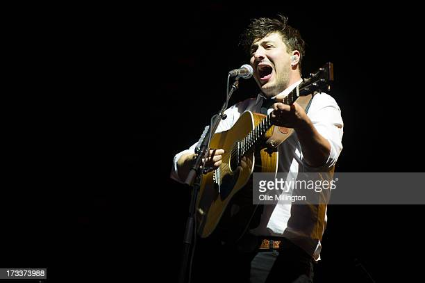 Marcus Mumford of Mumford Sons performs headlining Day 1 of the T in the Park festival at Balado on July 12 2013 in Kinross Scotland