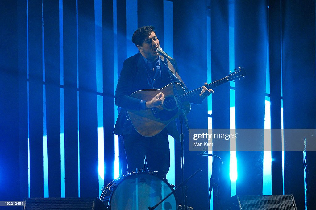 Marcus Mumford of Mumford & Sons performs on stage during the Brit Awards 2013 at the 02 Arena on February 20, 2013 in London, England.