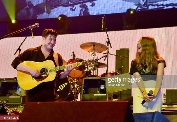 Marcus Mumford of Mumford Sons performs onstage with Maggie Rogers during iHeartRadio ALTer Ego 2018 at The Forum on January 19 2018 in Inglewood...