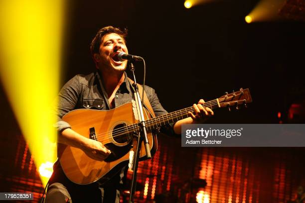 Marcus Mumford of the band Mumford Sons performs on September 4 2013 at The Xcel Energy Center in St Paul Minnesota