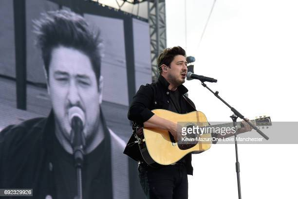 Marcus Mumford performs on stage during the One Love Manchester Benefit Concert at Old Trafford Cricket Ground on June 4 2017 in Manchester England
