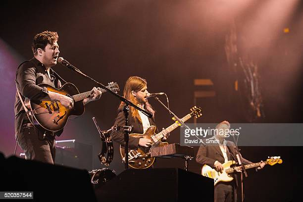 Marcus Mumford Winston Marshall and Ted Dwane of Mumford and Sons perform at BJCC on April 10 2016 in Birmingham Alabama