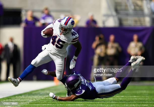 Marcus Murphy of the Buffalo Bills is knocked out of bounds by Mike Hughes of the Minnesota Vikings in the first half of the game at US Bank Stadium...