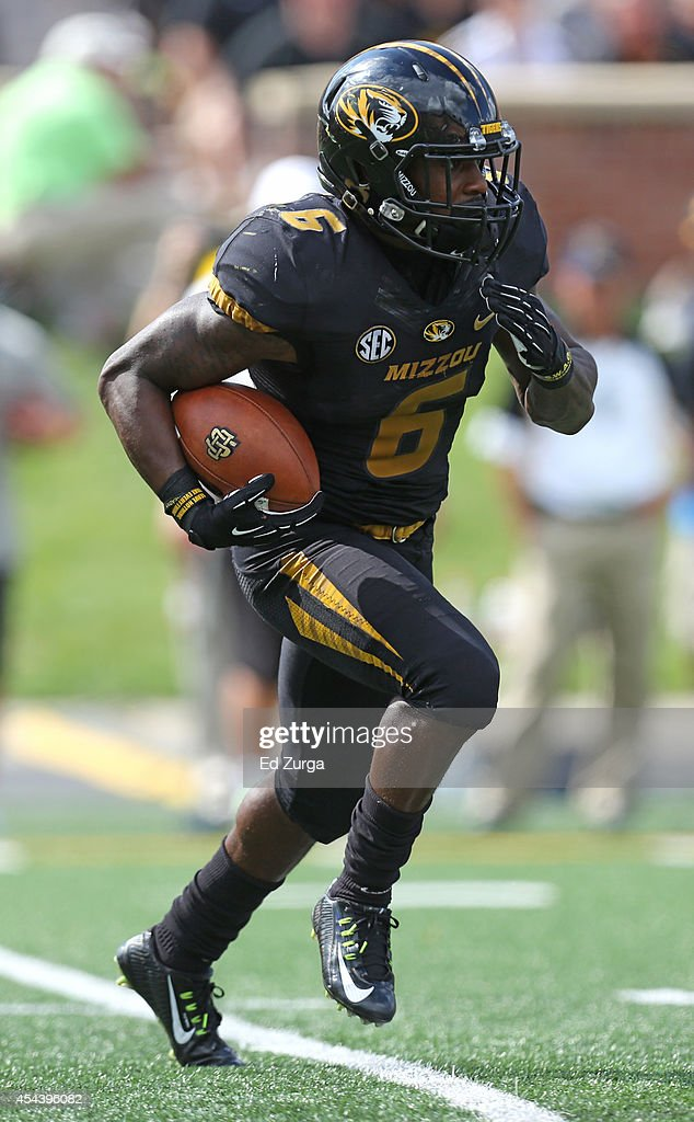 Marcus Murphy #6 of the Missouri Tigers runs a kick off in the first quarter during a game against the South Dakota State Jackrabbits at Memorial Stadium on August 30, 2014 in Columbia, Missouri.