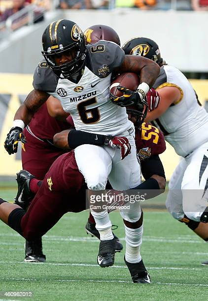 Marcus Murphy of the Missouri Tigers runs for yardage during the Buffalo Wild Wings Citrus Bowl against the Minnesota Golden Gophers at the Florida...