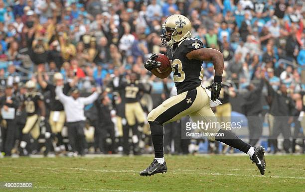 Marcus Murphy of the New Orleans Saints returns a punt for a touchdown against the Carolina Panthers in the third quarter during their game at Bank...