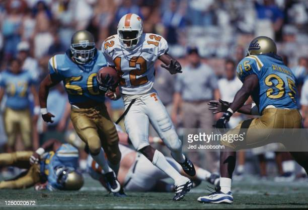 Marcus Nash, Wide Receiver for the University of Tennessee Volunteers avoids the tackle by the University of California, Los Angeles UCLA Bruins...