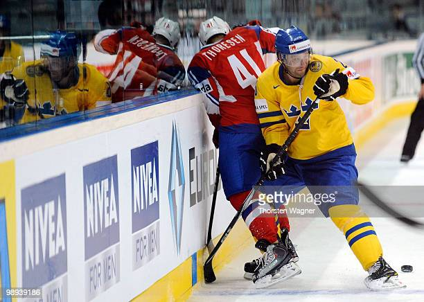 Marcus Nilson of Sweden battles for the puck with Patrick Thoresen of Norway during the IIHF World Championship group C match between Czech Republic...